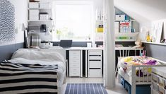 shared bedroom: workspaces behind beds w/ curtain divider