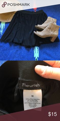Black pleated skater skirt Black pleated skater skirt. Excellent condition, worn maybe two times. Size medium but has elastic waist and could easily fit large. Fleurish Skirts Circle & Skater