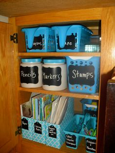 Kid's Craft Cupboard Re-Do organize the kids craft cupboard by buying bins at dollar tree , magazine holders at target dollar section and adding chalkboard labels ! http://organizethisfamily.blogspot.com/2013/03/kids-craft-cupboard.html