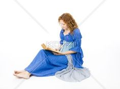 sitting and reading - A young woman sits on a white background as she reads