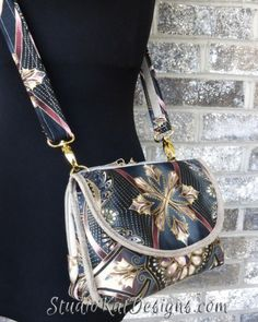 The HipBag Hybrid by StudioKat Designs can be worn as a shoulder bag AND as a cross-body bag! :)