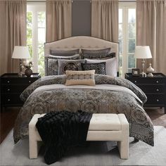 Create an elegant yet welcoming look on your bed with this 8 piece comforter set. The comforter and coordinating Euro shams feature an intricate woven jacquard medallion pattern with chenille texture in silver, black, and gold for contrast. This also includes two shams made of micro suede with embroidery details. The set includes two decorative pillows that feature embroidery and woven texture details. The comforter comes with a removable insert and decorative buttons for a secured fasten.