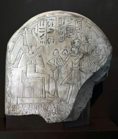 Limestone Limestone Stela of Amenhotep I and his mother Ahmose-Nofretary, 18th Dynasty, making an offering to Osiris. Ancient Egypt