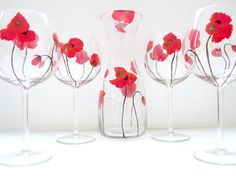 A five-piece Swirly Garden wine set consisting of a decanter and four wine glasses.