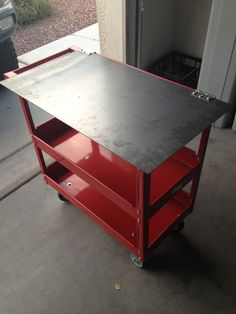 """I purchased this service cart from Harbor Freight to turn into a small rolling welding table. I purchased a 1/8"""" thick steel plate from a local scrap yard. I used regular door hinges to attach it to the cart. I know the plate is pretty thin but I only plan on welding small simple things so its good enough for what I will do. The plate being on top also acts as a storage drawer."""