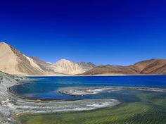 Pangong Lake, India; Photograph by Sanjeev Bhor.  Blue water swirls with green at Pangong Lake in Ladakh, India. The Himalayan lake lies on the Sino-Indian boundary and is the subject of many territory disputes between China and India.
