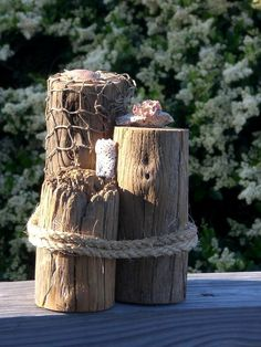 This decorative wharf three tier nautical pilings will complement any room in your home or office. 8 tall x 6 across and 18 around. Our wharf pilings are made with natural aged woods and shells from Saint Augustine Beach, FL.