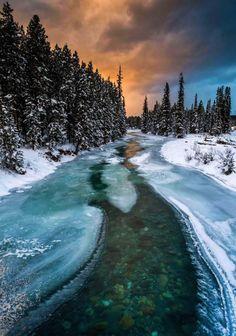 Partially frozen Bow River, Alberta, Canada