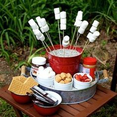 Set up an awesome S'mores station using bucket, skewers, marshmallows etc. I… Set up an awesome S'mores station using bucket, skewers, marshmallows etc. It's fun and your guests can make their own using their favourite ingredients. Bbq Party, Party Fiesta, Lake Party, Party Fun, Beach Party, Camping Parties, Outdoor Parties, Summer Parties, Backyard Parties