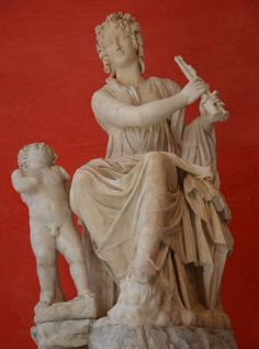 Euterpe, muse of lyric poetry, she is holding a aulos (double-flute) and has a small Eros at her feet, unearthed at Hadrian's Villa, Tivoli