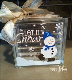 Let it Snow!  Cute vinyl snowman on glass block  Sign up for a monthly craft idea-newsletter:  http://www.wordplaydesigns.net/#!wp-newsletter/c1zmd