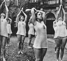 "Young German girls perform calisthenics as part of the ""Mind and Body"" Nazi policies for building physically and mentally able youth. These programs blanketed German schools and of course youth organizations. Giant annual events were regularly staged."