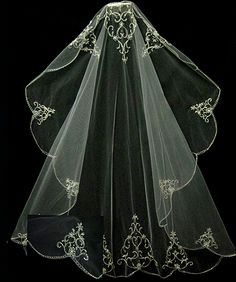 This has cool detailing for a Cinderella wedding veil