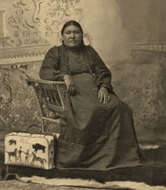Mahpiya Bagawin (Gathering of Clouds Woman) - Yanktonai Nation - Early 1900's.  Master  bead worker with one of her pictographic valises.