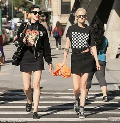 Match up:  The couple wore similar outfits with both in black miniskirts...
