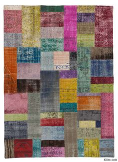 This piece is an over-dyed Turkish patchwork rug created by first neutralizing the colors and then over-dying to achieve a contemporary effect and bring old hand-made rugs back to life. The result is almost like an abstract painting. It is backed with cotton cloth as reinforcement.