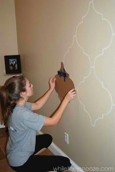 This could be cool, and subtle! for dining room instead of wallpaper! notice she has a level taped to it! go girl!