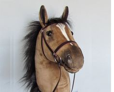 Hobby Horse with open mouth. Dun buckskin hobby horsing