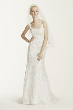 """Beautifully designed with a modern neckline, this exquisite lace wedding dress includes rich embellishments and allover beading!  Oleg Cassini, exclusively at David's Bridal - Extra Length.  4"""" extra length dress.  Also available in Regular. Check your local stores for availability.  Chapel train. Fully lined. Back button closure. Imported. Dry clean only. Cherish your wedding dress forever with our Gown Preservation Kit."""