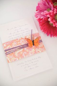 Michaels.com Wedding Department: Playful Butterfly Invitation Create an invitation that plays on your personality. Print a Gartner Studios pearl border invitation with a playful script font. Find a paper in your color palette. Choose from the many in Michaels scrapbooking aisles, like this pretty paisley. A skinny satin ribbon accented with a butterfly is just the right finishing touch. Courtesy of Gartner Studios®