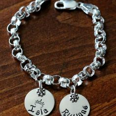 This Thick Rolo sterling silver charm bracelet includes two Circle Name Charms and makes a great Family Name Bracelet or Couples Bracelet. C...