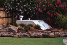 Landscape idea for outside storm cellar.