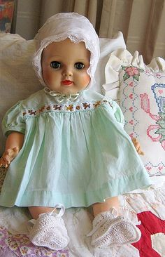 vintage baby doll wearing vintage green baby dress