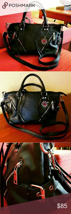 Black Satchel w Buckles & Tassel Accent🎉HP PRICE IS FIRM (See💲on TITLE) Make me an offer, it's YOURS ➖➖➖  ✨NWT✨  ⏩SO SLEEK & GORGEOUS!!! 😍 ⏩Made from soft faux leather, this tote features deep, luxuriously rich black color with sleek silver hardware & tassels ⏩High-grade material ⏩Sturdy tubular dual handles ⏩Exterior➖Top zipper closure, 2 asymmetrical zip pocket, adjustable side buckles ⏩Interior➖1 zip pocket, 2 slip pockets, fully lined ⏩DETACHABLE shoulder strap that is so comfortable…