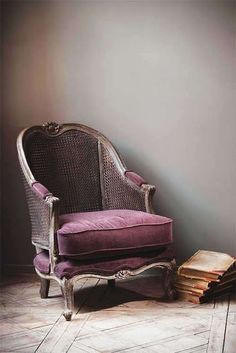 old fashioned chair and a pile of books