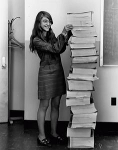 "Margaret Hamilton was the lead software engineer of the Apollo Project. Here she stands next to the code she wrote by hand and that was used to take humanity to the moon (1969). Hamilton's work prevented an abort of the Apollo 11 moon landing. Hamilton coined the term ""software engineering."" Hamilton was a badass."