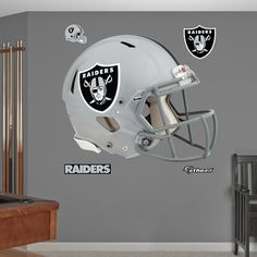 Show your NCAA pride with these Fathead officially licensed NCAA wall decals and graphics. Featuring the team colors and helmet of your favorite college team, these premium wall graphics are perfect for adding team spirit to any room. Oakland Raiders Man Cave Ideas, Oakland Raiders Football, Raiders Helmet, Raiders Baby, Helmet Logo, Raider Nation, Football Helmets, Wall Decals, Wall Stickers