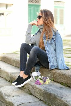 Blue jeans jacket under grey stylish sweater with dark grey jeans and shoes