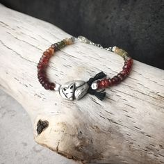 """Autumn Inspired! This handmade pure silver cutie is adorned with multicolored spinels and a dash of red garnets. Complete with mini black tassels, this one-of-a-kind whimsical bracelet makes the perfect """"go to"""" fall accessory! Size 7 ($86)  #animaljewelry #beadedbracelet #fallfashion"""