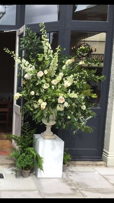 Wedding flowers white urn display bouquet arrangement tall dramatic beautiful