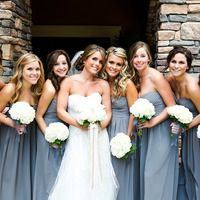 I love everything about this: Dusty Carolina Blue and white bouquets (hydrangeas?) ... sooo pretty! How perfectly do those ribbons match the bridesmaids' dresses?!