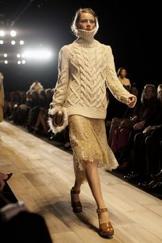 A large, even oversized sweater on top of a flowy skirt or dress is an instant boho classic. Michael Kors Fall/Winter 2012