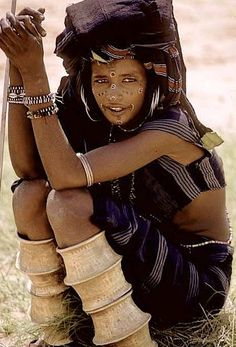 Africa Wodaabe ( Bororo / Fulani ) nomad girl attending a Yakey , a male dance and beauty contest. Photo taken by victor Englebert (www.