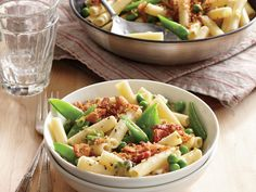 Two-Pea Pasta with Bacon Breadcrumbs | Including soups, stews, and more, and incorporating flavors from around the world, these dishes highlight the versatility of noodles―and none takes more than 20 minutes to cook!