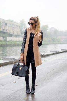 Camel and black: black outfit and a camel / black coat. via scentofobsession
