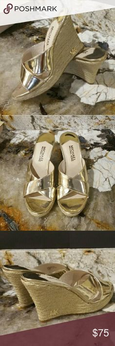 Michael Kors Metallic Pale Gold Wedge  3.75 Heel NWB Stunning wedges, metallic pale gold straps w/ raffia base. Base has tiny MK Gold Logo. Can be dressed up or dressed down given the gold/raffia combo. Very comfortable to walk in. Selling bc I changed careers and live in flats now. Michael Kors Shoes