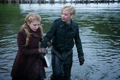 Before this scene Rudy followed Liesel to the mayor's house. He found out that she's been stealing books from the mayor. In this scene, Rudy jumped in the river to save her book. After he got it he asked for a kiss. Rudy was a loyal friend to Liesel.