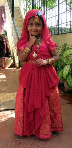 Young girl dressed up as Radha (Hindu Goddess) on Janmashtami (annual commemoration of the birth of the Hindu diety, Krishna, the 8th Avator of Vishu.