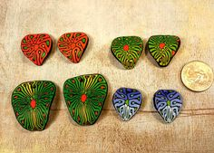 Four pairs of handmade polymer clay leaf beads  by crystalsoflove, $8.00