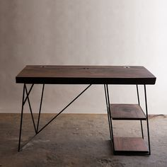 The first one of these Walnut Slab Desks was completed a year...