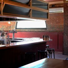 Recycled Messmate timber bar top, standing tables and floating tables at the Victoria Hotel in Footscray, Melbourne. Sustainable fit out. Design: Projects of Imagination. Build: Ficus Constructions. Timber: Timber Revival.
