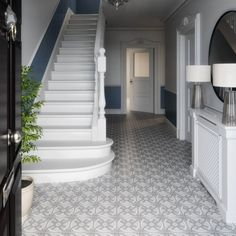 This design is inspired by a Victorian earthenware tile design, in the style of a medieval floor tile, held in the V&A collection. In cool shades of complementary grey, this Abbey Circle wall and floor porcelain tile has an authentic and handmade feel. Hall Flooring, Porch Flooring, Grey Flooring, Victorian Hallway Tiles, Edwardian Hallway, Victorian Flooring, Grey Hallway, Tiled Hallway, Hallway Bench