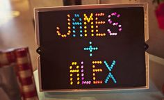 HELL. YES. (And my brother gave me an old school Lite Brite earlier this year!!!)  Lite-Brite Wedding Decoration