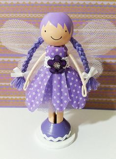 OOAK Purple Daisy Fairy Miniature Wooden Clothespin Doll..This super cute purple fairy wooden clothespin doll stands just over four inches tall, and is uniquely hand painted in vibrant colors.