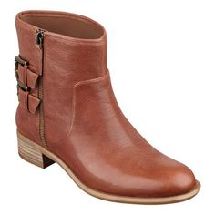 """A sleek moto-inspired silhouette punctuated with belted strap details make these foot-flattering round-toe booties an ideal companion with a wide variety of looks this season. Side zip for easy on/off. Leather or suede upper. Padded insole. Imported. 1 1/4"""" low heels."""