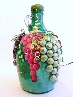 garrafa decorada con piedrecitas